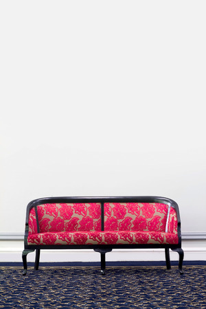 red sofa: red fabric sofa in front of white wall