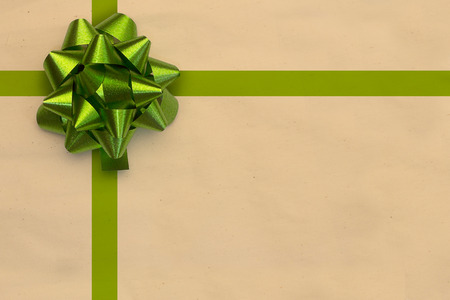 to present: green bow for present on beige background