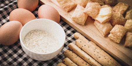 grissini: Fresh baked homemade grissini bread sticks and  crispy pie with egg  on vintage fabric background