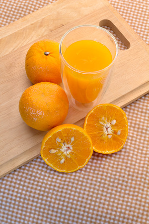orange: Oranges cut set  and glass of orange juice on wooden base