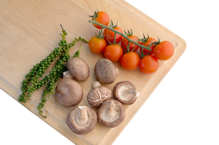 fresh cheery tomato mushroom and fresh pepper on wooden board view from top .jpg