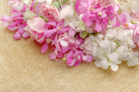 The background image of the colorful flowers with gloden table top