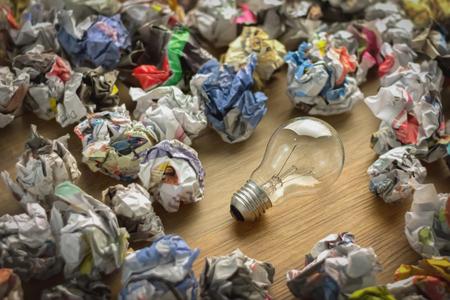 bad idea: good idea and bad idea concept image symbol pf bulb and trash