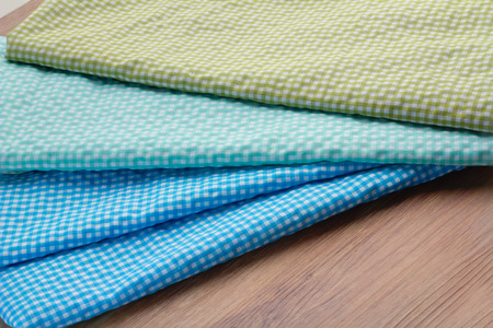 colorful checkered tablecloths on wooden table