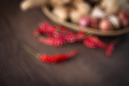 GINGER AND CHILI ON DARK WOOD BULR IAMGE FOR BACKGROUND USE