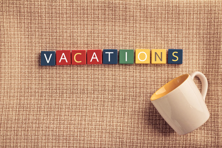 vacation concept with vintage color idea by letter word box with coffee cup.jpg