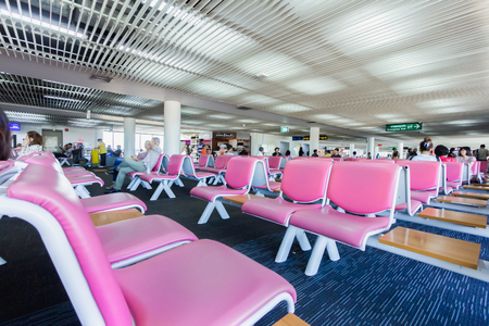 blue carpet: Airport Seating with pink color and blue carpet in donmeung bangkok thailand international airport