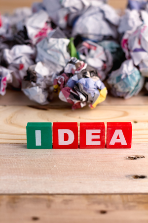buzzword: idea buzzword colorful cubes series with trash behind.jpg Stock Photo
