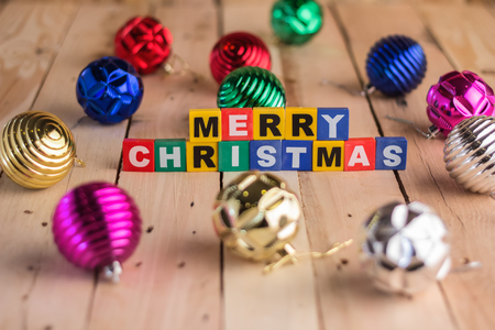 chritmas: merry chritmas  decoration with wooden text and shiny balls on wooden floor.jpg