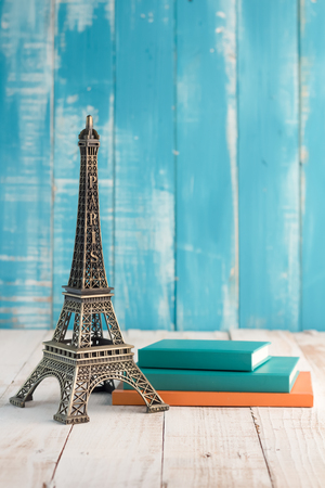 holiday concept paris gift on sky color wood background