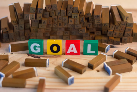 goal text with wood stampers goal concept Stock Photo