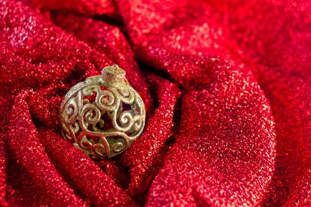 xmas decoration items shiny balls and red shiny fabric