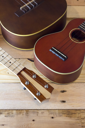 ukeleles on the wooden deck in warm color tone Stock Photo