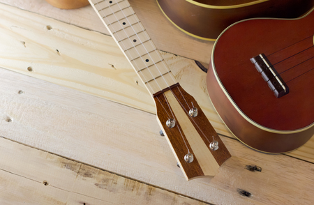 mellowness: ukeleles on the wooden deck in warm color tone Stock Photo