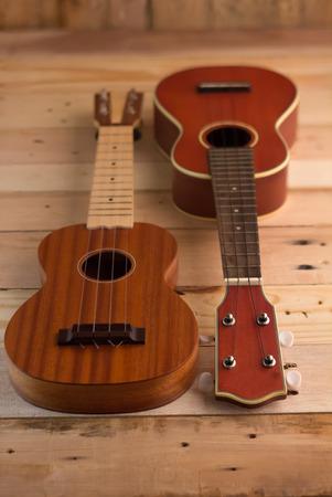 ukuleles on the  light brown wooden terrace