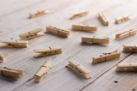 clothes pin: wooden clothes pin on a wood background Stock Photo