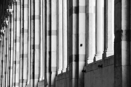 campo dei miracoli: pattern of column Camposanto building in Pisa, Italy black and white image