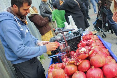 Istunbul Tulkey december 2014  a man selling Pomegranate juice in market.JPG