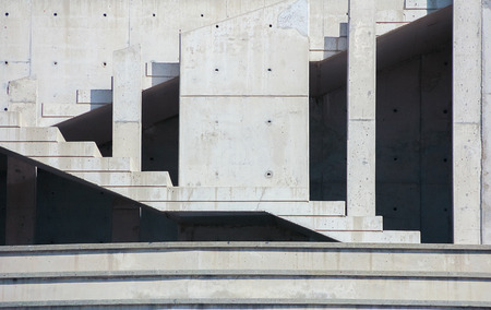 materiales de construccion: Abstract background with concrete wall and staircase of modern building