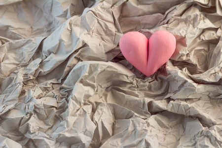 broken love: crumpled paper with heart shape object concept for broken love heart