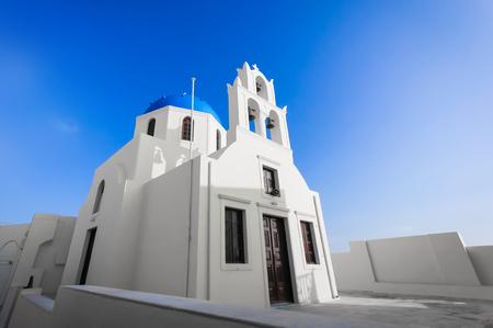 church bells: Traditional blue dome church in Santorini Greece evening time