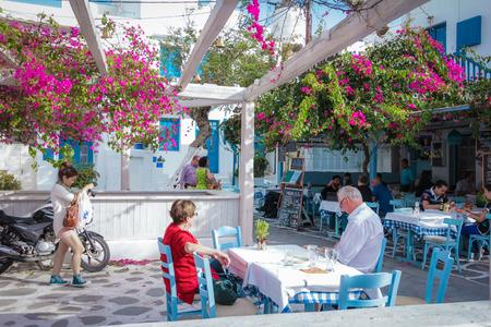 taverna: Mykonos Greece November 21 2013 :Restaurant with tree and flower in Mykonos greece Editorial