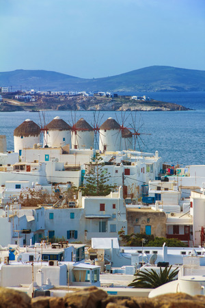 myconos: four famous windmills overlooking Little Venice and Mykonos old town, Mykonos, Cyclades, Greece