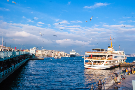 eminonu: ISTANBUL,TURKEY- November 25: Cruise ferries in Eminonu Port near Yeni Cami and Galata Bridge  Istanbul,Turkey. The Eminonu waterfront is a major dock for ferryboats in Istanbul.