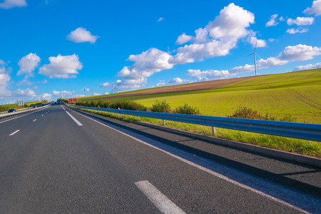 agricultural area: Country road in a beautiful agricultural area in northern France with nice sky background