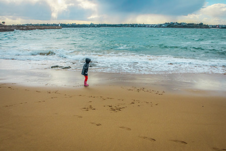 clody: kids on the beach at sunset with clody background