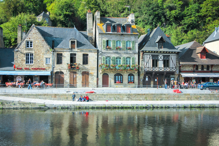dinan: view of old tradition house  with blue sky near the river port of Dinan France Editorial