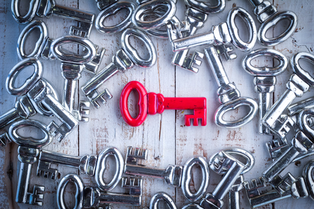 generational: red key with silver keys background success business concept Stock Photo