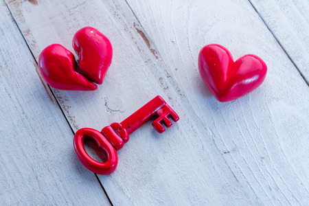 wedding heart: Retro red key with red heart on wooden table valentine concept Stock Photo