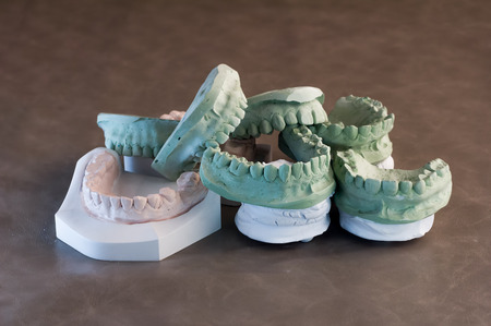 molars: set of dentures. False teeth on brown background