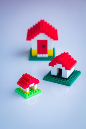 housing problems: house business concept : mini model house on white background Stock Photo