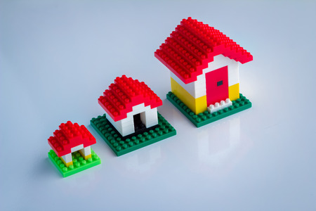 toy house: house concept mini toy house on white background