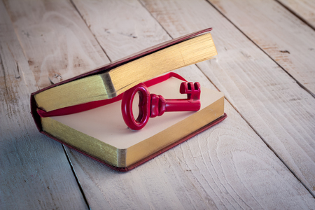 old diary: Old diary and red keys  white wooden floor