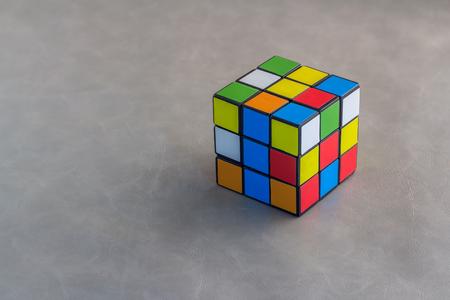 unsolved: Rubiks Cube on grey background.jpg