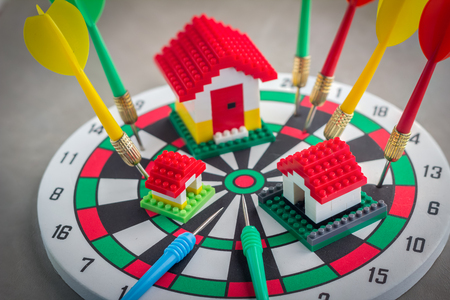 foreclosed: House on dartboard business concept Stock Photo