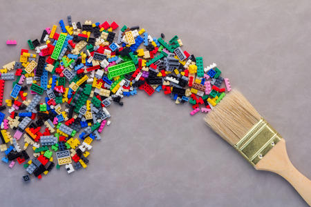 idea splash with paint brush and plastic block toy Creative concept.jpg