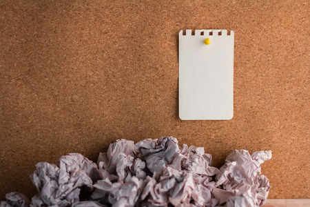 note paper pin: note paper pin on cork texture background with trash paper ideal concept Stock Photo