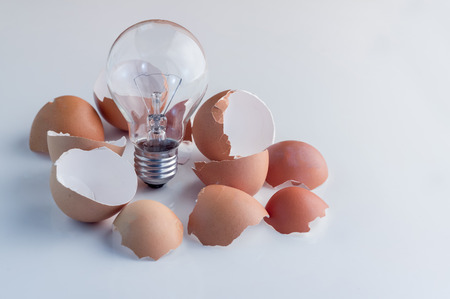 out of business: From the broken egg the shone lamp is pulled out Business Concept ideas