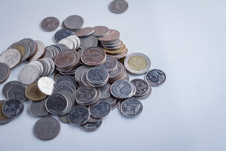 mangement: coins on white table Money mangement concept.jpg Stock Photo