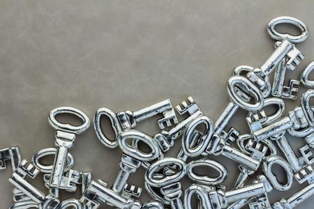 passkey: background of many gray keys on leather background