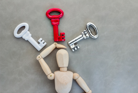 option key: man confuse with many keys business solution concept Stock Photo