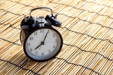 bamboo mat: alarm clock on bamboo mat  texture background