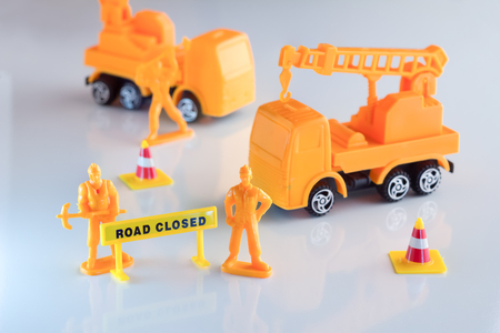 road closed: road closed concept toy object with signage on white floor.jpg