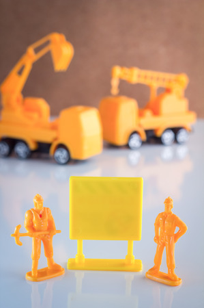 temporarily: yellow blank signage for your text with toy object on white floor Stock Photo