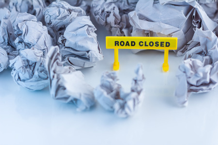 road closed: road closed signage wth trash paper with white background
