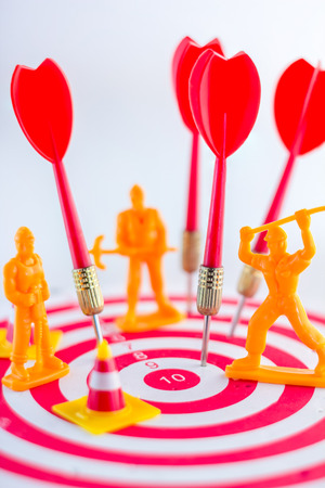 bull     s eye: workmen figure placed on a dartboard Business concept